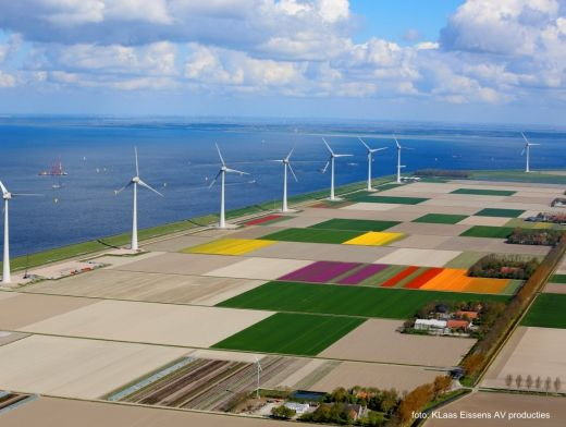 Dutch wind turbines on land reclaimed from the sea.